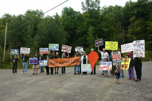 CCAC Members hold signs at the entrance to Highland Landfill 2014